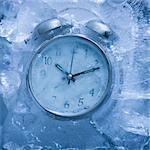 alarm clock in a block of ice
