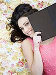 woman lying on a blanket