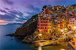 Dusk view of the colorful sea village of Riomaggiore, Cinque Terre, Liguria, Italy