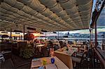 Cip's Club restaurant of the 5 star Hotel Cipriani, at sunset, looking towards St. Maria della Salute Basilica, Giudecca, Venice, Veneto, Italy.