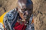 Africa, Kenya, Narok County, Masai Mara. Maasai dressed in traditional attire.