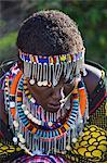 Africa, Kenya, Narok County, Masai Mara. Maasai women dressed in traditional attire.