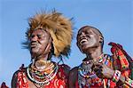 Africa, Kenya, Narok County, Masai Mara. Masai men dressed in traditional attire