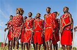 Africa, Kenya, Narok County, Masai Mara. Masai men dancing at their homestead