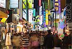 Asia, Republic of Korea, South Korea, Seoul, neon lit streets of Myeong-dong