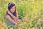 Beautiful teenage girl on the summer field