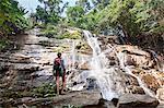 Backpacker hiking in the tropical rainforest