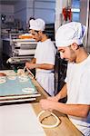 Preparing pretzel dough in bakery