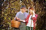 Family picking apples, Munich, Bavaria, Germany