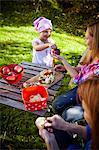 Women peeling apples in garden, Munich, Bavaria, Germany