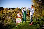 Grandparents with granddaughter gardening, Munich, Bavaria, Germany