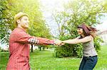 Young couple holding hands in park, Osijek, C roatia