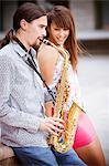 Man playing the saxophone to woman, Osijek, Croatia