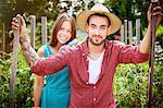 Portrait of young couple in vegetable garden
