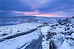 Sunrise above a snow covered moorland, Belstone Tor, Dartmoor National Park, Devon, England, United Kingdom, Europe