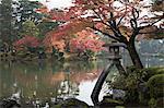 Kenrokuen Garden with Kotojitoro lantern in autumn, Kanazawa, Ishikawa Prefecture, Central Honshu, Japan, Asia
