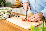 Person preparing salad