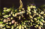 Full frame shot of fresh asparagus arranged in supermarket