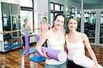 Women take a break on Pilates class