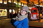 Senior woman holding hot wine punch at Christmas Market, Bad Toelz, Bavaria, Germany