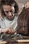 Carpenter repairing an antique bone box at workshop, Bavaria, Germany