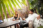 Couple enjoying drink on patio