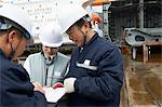 Workers discussing plans at shipyard, GoSeong-gun, South Korea
