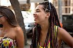 Two young women chatting on street, Copacabana town, Rio De Janeiro, Brazil