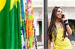 Young woman chatting on smartphone, Copacabana town, Rio De Janeiro, Brazil