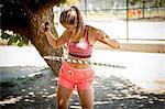 Young woman hula hooping outdoors
