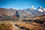 Mountain bikers on dirt track, Valais, Switzerland