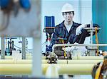 Portrait of apprentice engineer in power station