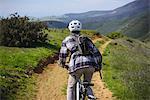 Cyclist mountain biking, San Luis Obispo, California, United States of America