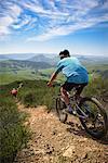 Cyclists mountain biking, San Luis Obispo, California, United States of America