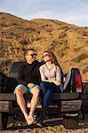 Couple on beach, Malibu, California, USA