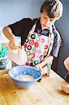 Teenage boy using mixer
