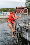 Girl climbing on jetty