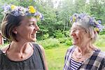 Smiling women wearing flower wreath