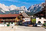 Gasthof Wilder Kaiser and Town Hall in front of Wilder Kaiser in Autumn, Going am Wilden Kaiser, Tyrol, Austria