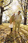 Senior Japanese couple in a city park in Autumn