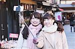 Young Japanese women enjoying trip in Kawagoe, Japan