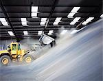 Digger loading bulk fertilizer in port