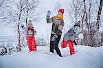 Mother and two sons throwing snowballs, Hemavan,Sweden