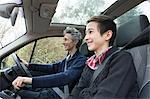 Mature man and teenage son driving car