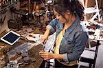 Female mechanic in workshop