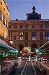 France, Paris, 75, 1st ARRT, Rue de Rohan, 2 buses at night.