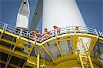 Portrait of engineers on wind turbine on offshore wind farm