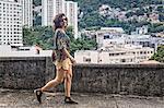 Fashion model walking and smiling at camera
