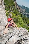 Female hiker climbing rock formation on way to Daecheongbong peak,  Seoraksan National Park in South Korea