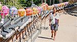 Female tourist strolling past rows of lanterns, Naksansa Temple, Naksansa, Yangyang, Gangwon province, South Korea